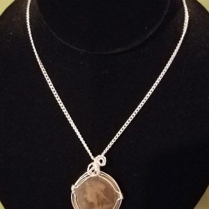 Victorian penny wrapped in silver wire