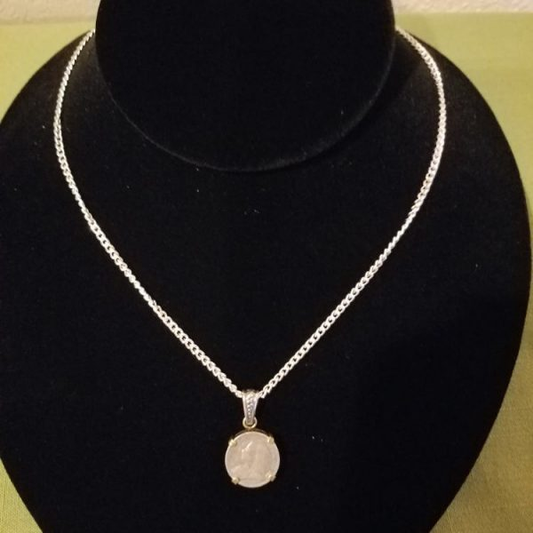 Victorian threepence set in silver