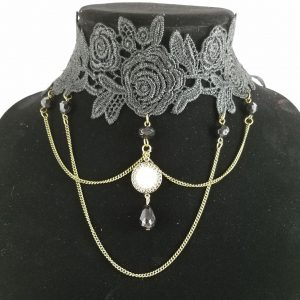 Victorian threepence on lace choker collar